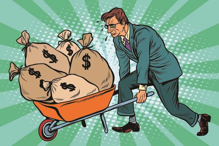 Geld mit Schubkarre schieben