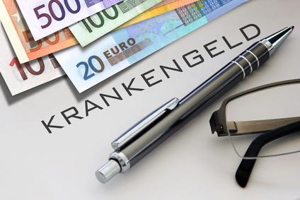 Krankengeld Schriftzug mit Geldscheinen