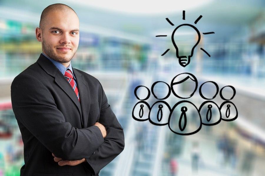 Unternehmer neben Mitarbeiter-Grafik