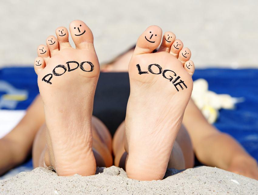 Füße mit Aufschrift Podologie