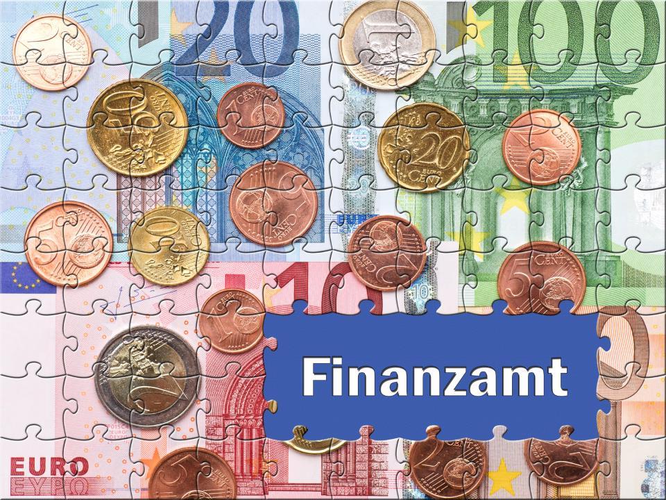 Puzzle mit Geld und Aufschrift Finanzamt